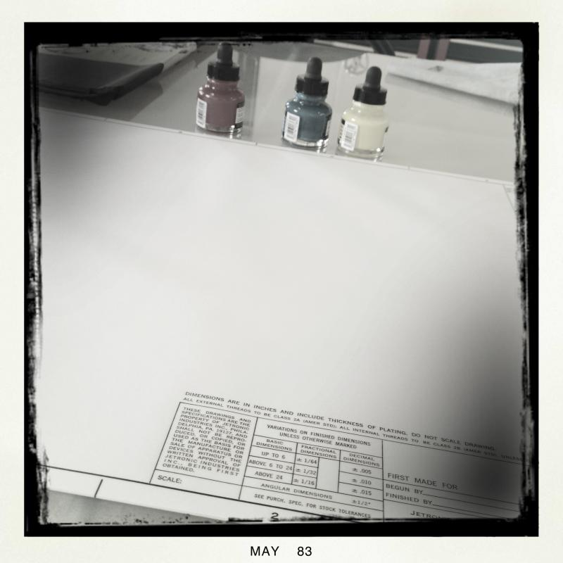 three ink bottles and vellum sheets