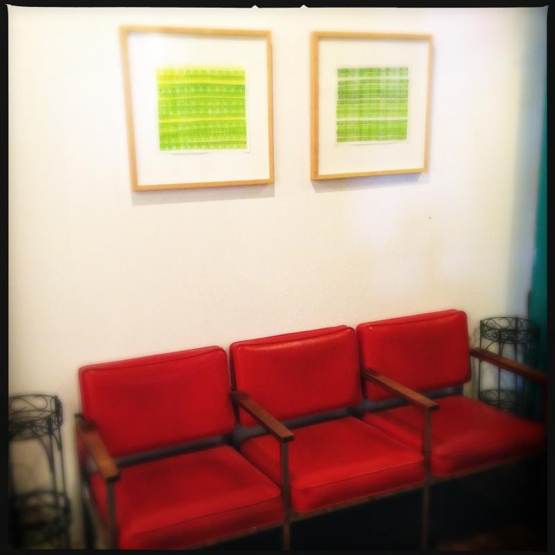 green drawings by the red chairs