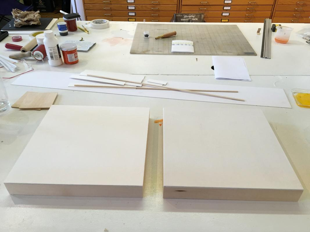 two prepped panels for drawings by Stella Untalan